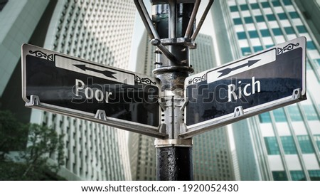 Street Sign the Direction Way to Rich versus Poor Royalty-Free Stock Photo #1920052430