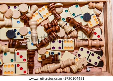 A variety of board game pieces. A background miscellaneous board game pieces. Royalty-Free Stock Photo #1920104681