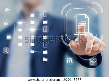 Document Management System (DMS) in addition to digitization and process automation to efficiently manage files, knowledge and documentation in enterprise with ERP. Corporate business technology Royalty-Free Stock Photo #1920143777