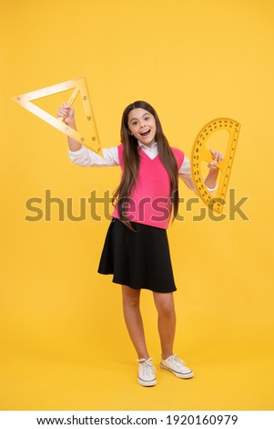 geometric shapes. measure the angle. child with triangle. amazed teen girl hold protractor ruler. back to school. algebra and geometry. kid study math. stem disciplines. concept of education.