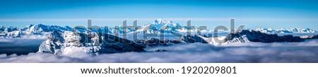 Winter snow mountain peak panorama. Snowy mountain winter panorama. Winter mountain snow panorama. Winter mountain snow panoramic landscape Royalty-Free Stock Photo #1920209801