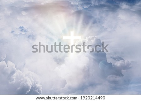 Cross silhouette in sky with clouds. Resurrection of Jesus