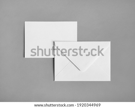 Two blank paper envelopes on gray paper background. Back and front. Flat lay. Royalty-Free Stock Photo #1920344969