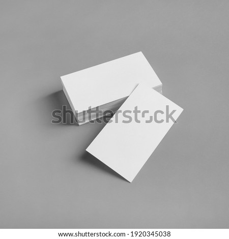Blank white business cards on gray paper background. Mockup for ID. Template for graphic designers portfolios.