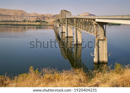 Lyons Ferry Bridge Snake River Washington State. The Lyons Ferry Bridge spanning the Snake River in Eastern Washington near Lyons Ferry State Park                                  Royalty-Free Stock Photo #1920404231