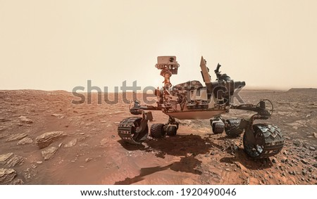Rover on Mars surface. Exploration of red planet. Space station expedition. Perseverance. Expedition of Curiosity. Elements of this image furnished by NASA Royalty-Free Stock Photo #1920490046