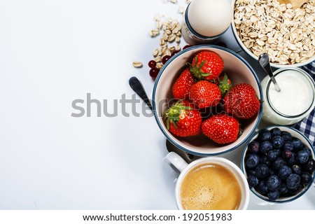Healthy breakfast - yogurt with muesli and berries - health and diet concept #192051983