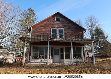 Abandoned and neglected house photographed in the winter season.                                 Royalty-Free Stock Photo #1920520856