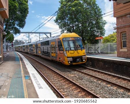 Commuter train approaching Homebush train station Sydney NSW Australia Royalty-Free Stock Photo #1920685562