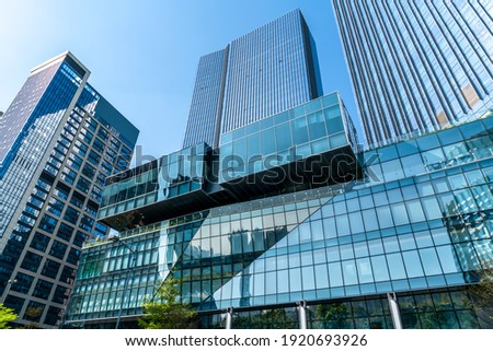 Looking up at the commercial buildings in downtown Guangzhou, Ch Royalty-Free Stock Photo #1920693926