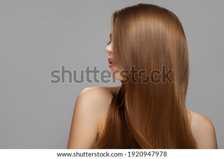 Woman's clean styled hair. Half of the face is covered with brunette hair Royalty-Free Stock Photo #1920947978