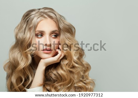 Cheerful woman with blonde curly hairstyle on white background Royalty-Free Stock Photo #1920977312