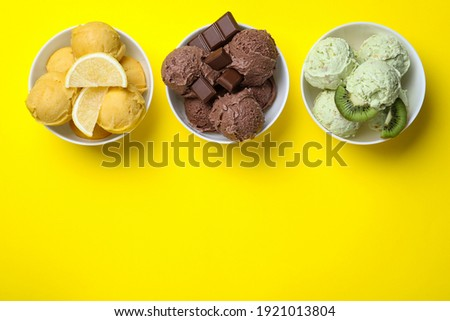 Different delicious ice creams on yellow background, flat lay. Space for text Royalty-Free Stock Photo #1921013804