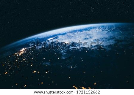 Planet earth globe view from space showing realistic earth surface and world map as in outer space point of view . Elements of this image furnished by NASA planet earth from space photos. Royalty-Free Stock Photo #1921152662