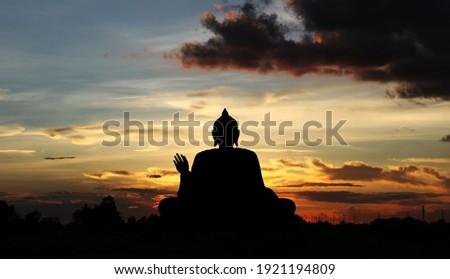 Shadow of the buddha, buddha statue at sunset