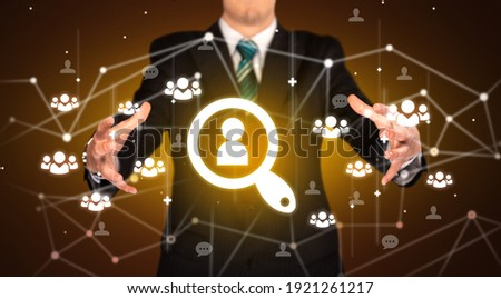 Hand holdig lookup icon around his hands, Social networking concept