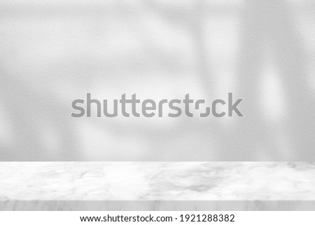 White Marble Table with Tree Branch Shadow on Concrete Wall Texture Background, Suitable for Product Presentation Backdrop, Display, and Mock up. Royalty-Free Stock Photo #1921288382