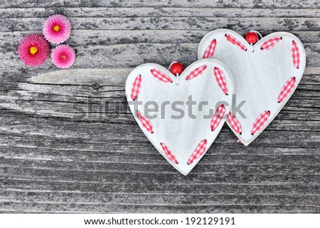 Two hearts with flowers on a wooden background old #192129191