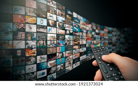Television streaming, TV broadcast. Multimedia wall concept. Royalty-Free Stock Photo #1921373024