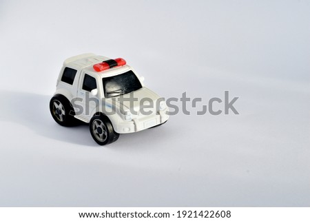Children's plastic toy. Police car with lights on the roof.
