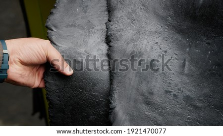 One of the first stages of production of rubber products at the plant. Close-up of raw material seam texture. Medium wholesale manufacturing technology, Royalty-Free Stock Photo #1921470077