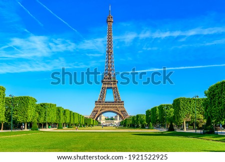 Paris Eiffel Tower and Champ de Mars in Paris, France. Eiffel Tower is one of the most iconic landmarks in Paris. The Champ de Mars is a large public park in Paris Royalty-Free Stock Photo #1921522925