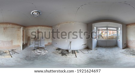 360 Degree panoramic sphere photo of construction working being done on an old British terrace house front room showing new plaster boards and a new double glazed front window