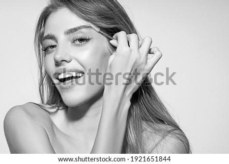 Eyebrows correction. Shape. Perfect natural eyebrows and eyelashes. Lush eyebrow. Natural make up. Beauty. Eyebrows and eyelashes close up Royalty-Free Stock Photo #1921651844