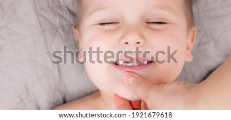 Kid patient open mouth showing caries teeth decay. Closeup of unhealthy baby teeth. Dental medicine and healthcare. Royalty-Free Stock Photo #1921679618