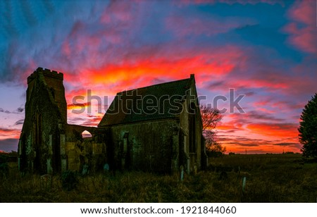 Sunrise ruined church silhouette. Ruined church sunrise scene. Sunrise ruines. Ruines at sunrise Royalty-Free Stock Photo #1921844060