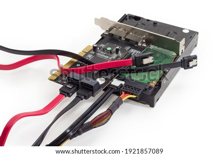Hard disk drive and disk array controller card with connected cables, different SATA data cables, close-up on a white background