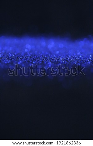 Wallpaper phone shining glitter.Glitter radiance surface.  blue glitter  on a black background.Festive bright background. New Year and Christmas background. Shining texture Royalty-Free Stock Photo #1921862336