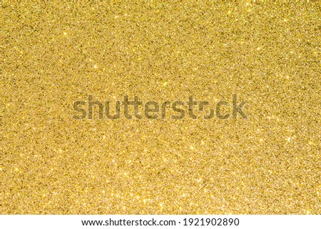 Gold glitter texture background sparkling shiny wrapping paper for Christmas holiday seasonal wallpaper  decoration, greeting and wedding invitation card design element Royalty-Free Stock Photo #1921902890
