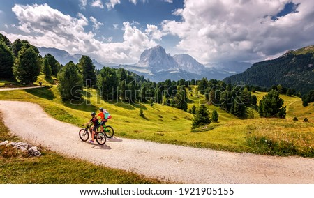 Beautiful alpine countryside. Awesome Alpine highlands in sunny day. Amazing Nature Scenery of Dolomites Alps. Epic Scene in the mountains place. Active recreation concept Royalty-Free Stock Photo #1921905155