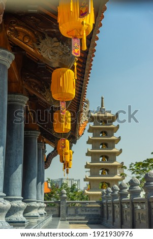 Beautiful traditional yellow silk lanterns are are hanging on the roof of the temple at Vinh Nghiem monastery in Ho Chi Minh city, Vietnam. Religion concept. Royalty-Free Stock Photo #1921930976