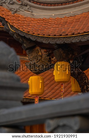 Beautiful traditional yellow silk lanterns are are hanging on the roof of the temple at Vinh Nghiem monastery in Ho Chi Minh city, Vietnam. Religion concept. Royalty-Free Stock Photo #1921930991