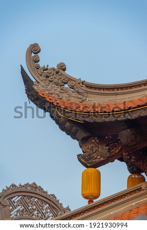 Beautiful traditional yellow silk lanterns are are hanging on the roof of the temple at Vinh Nghiem monastery in Ho Chi Minh city, Vietnam. Religion concept. Royalty-Free Stock Photo #1921930994