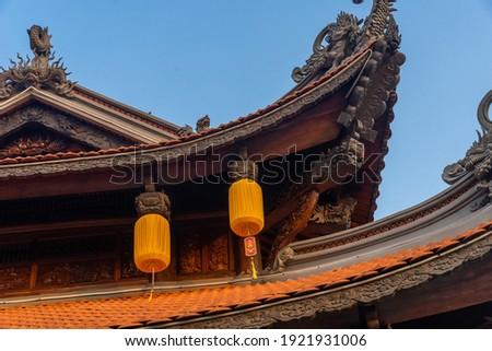 Beautiful traditional yellow silk lanterns are are hanging on the roof of the temple at Vinh Nghiem monastery in Ho Chi Minh city, Vietnam. Religion concept. Royalty-Free Stock Photo #1921931006