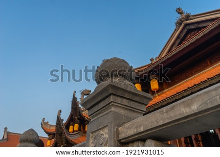 Beautiful traditional yellow silk lanterns are are hanging on the roof of the temple at Vinh Nghiem monastery in Ho Chi Minh city, Vietnam. Religion concept. Royalty-Free Stock Photo #1921931015