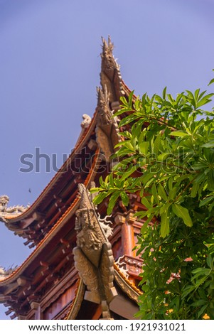 Beautiful traditional decorations and details on the roof of the temple at Vinh Nghiem monastery in Ho Chi Minh city, Vietnam. Religion concept. Royalty-Free Stock Photo #1921931021