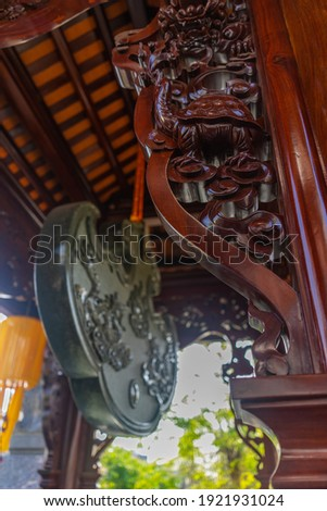 Beautiful traditional decorations and details on the roof of the temple at Vinh Nghiem monastery in Ho Chi Minh city, Vietnam. Religion concept. Royalty-Free Stock Photo #1921931024