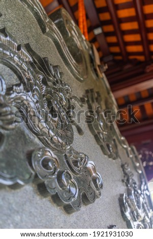 Beautiful traditional decorations and details on the roof of the temple at Vinh Nghiem monastery in Ho Chi Minh city, Vietnam. Religion concept. Royalty-Free Stock Photo #1921931030