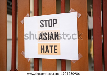 Stop Asian Hate sign was attached on the house fence Royalty-Free Stock Photo #1921980986