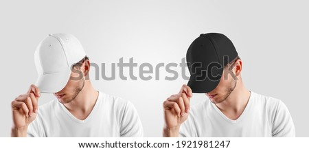 A template for a headdress for a guy, straightening a visor, for advertising in an online store. Mockup of a white, black cap isolated on background. Set of hats, panamas, sports accessories, rap Royalty-Free Stock Photo #1921981247