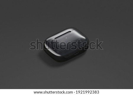 Blank black small closed headphones case mockup lying, dark background, 3d rendering. Empty smart wireless earmuff mock up, side view. Clear portable box for earbuds sound template.
