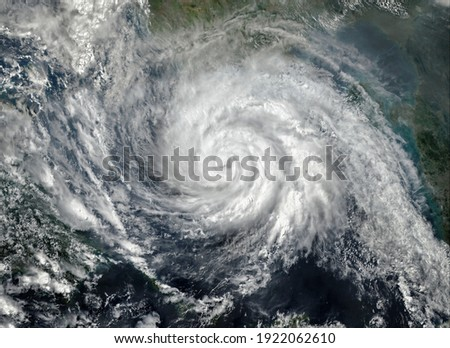 Super Typhoon, tropical storm, cyclone, hurricane, tornado, over ocean. Weather background. Typhoon,  storm, windstorm, superstorm, gale moves to the ground.  Elements of this image furnished by NASA. Royalty-Free Stock Photo #1922062610