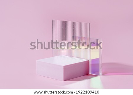 Geometric shapes podium for product display. Monochrome platform  with gloss acrylic sheets on pink background. Stylish background for presentation. Minimal style. Royalty-Free Stock Photo #1922109410
