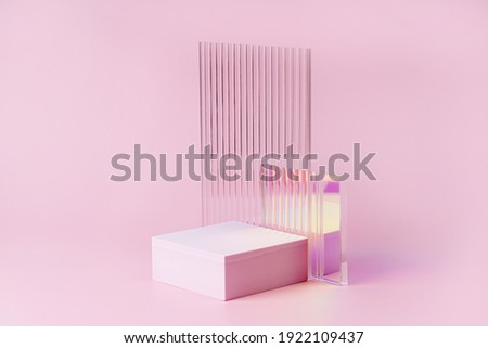 Empty podium for product display. Monochrome Pedestal with ribbed  glass on pink background. Stylish background for presentation. Minimal style. Royalty-Free Stock Photo #1922109437