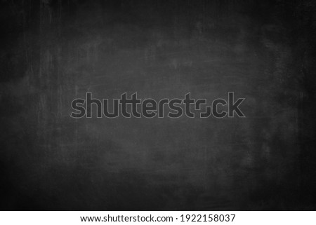Chalkboard or black board texture abstract background with grunge dirt white chalk rubbed out on blank black billboard wall, copy space, element can use for wallpaper education communication backdrop Royalty-Free Stock Photo #1922158037