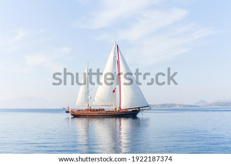Amazing view to sailboat with white sails in the sea Royalty-Free Stock Photo #1922187374